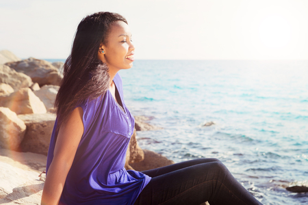 african worship: Gorgeous young lady relaxing near the water Stock Photo