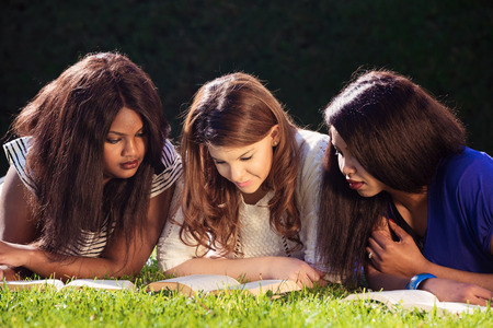 research study: Close up of three young girls studying for exams Stock Photo