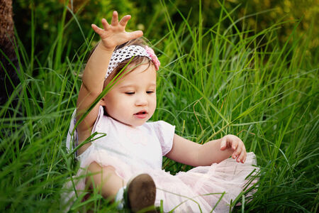 Cute little toddler having fun in the grass