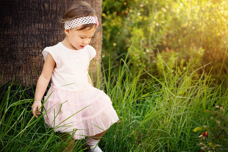 Gorgeous little girl outdoors in forest Stock Photo