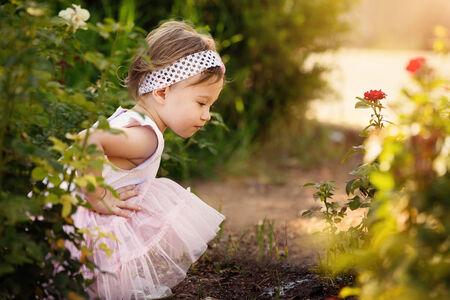 growing up: Gorgeous little girl outdoors in green garden