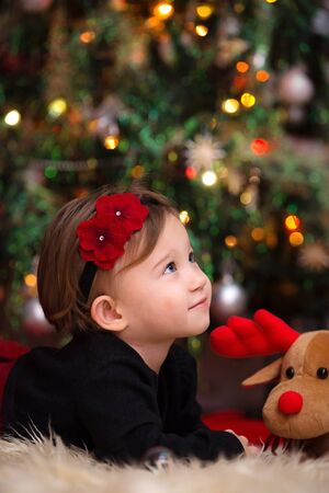 Beautiful Little Girl Looking Up Expecting Her Christmas Gifts
