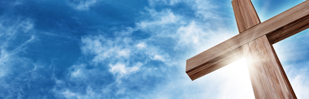 cross light: Wooden Cross with a Bright Blue Sky and Sun