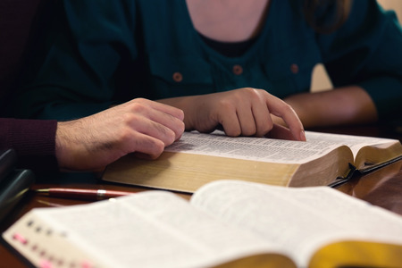theology: Young couple studying the Word of God together