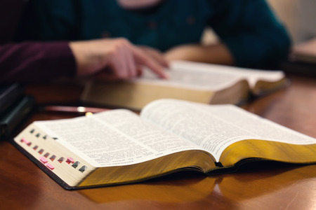 Young couple studying the Word of God together