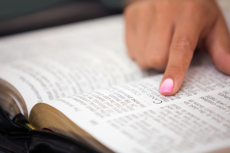 Close up of a lady reading the Word of God
