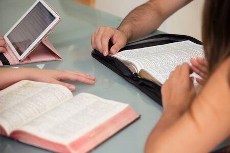theology: Close-up of People Reading the Word of God together