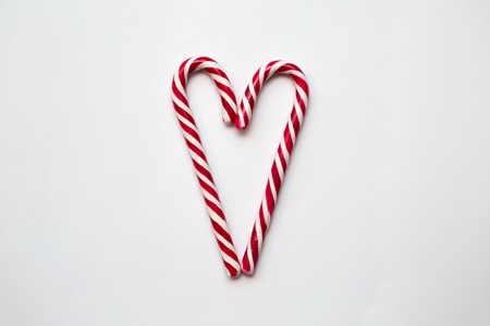 Two Candy Canes Making a Heart Stock Photo