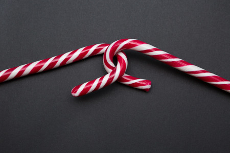 hooked: Two Candy Canes Making Hooked Together