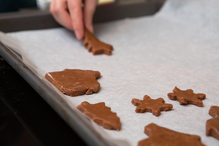 gingerbread man: Different Biscuit Shapes On Baking Sheet Ready For The Oven