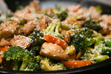 scrumptious: Delicious Asian Sesame Chicken and Vegetable Stir Fry Stock Photo