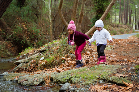 Young Children Looking At The Stream Flowing photo