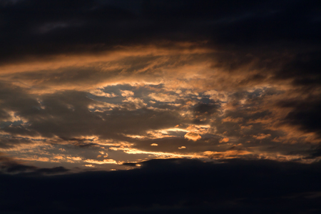 the firmament: Sun Setting Behind Dark Clouds