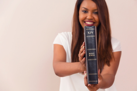 Happy Girl Proudly Showing Her King James Bible