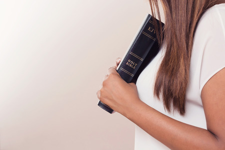 Girl Holding Her Holy King James Bible