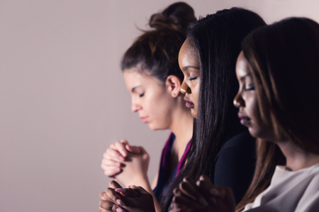 Three Dedicated Christian Ladies Praying To God