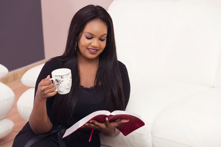 Young Woman Studying the Word Of God in the Morning
