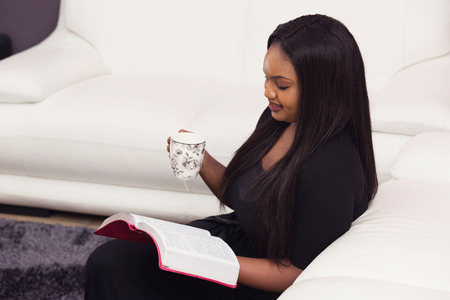 Young Woman Studying the Word of God in the Morning Stock Photo