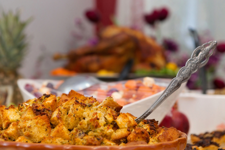 Bountiful Thanksgiving Table with Close Up of Stuffing Stock Photo