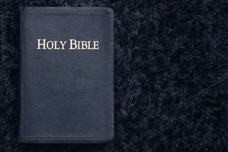 Top View of Holy Bible On Dark Texture Stock Photo