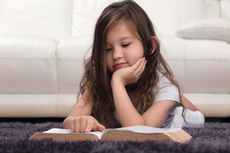 Young Child Learning the Word of God Stock Photo