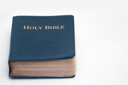 Top View of Holy Bible on White Platform