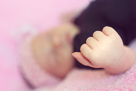 Adorable Little Baby Girl Sleeping Peacefully on a Pink Blanket