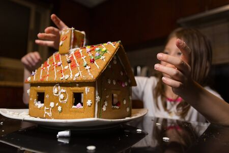 Children Building Their Very First Gingerbread House