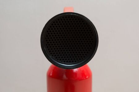 Home Fire Extinguisher with Red Base and Black Nozzle Foto de archivo