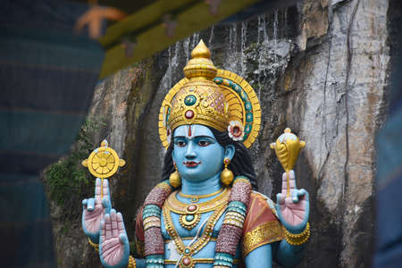 Gombak, Selangor, Malaysia 08.14.2019: Beautiful and amazing Dravidian architecture with stunningly colorful hindu statues, decorations, signs and symbols inside Batu Caves