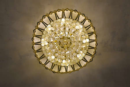 Bottom up view of an amazing stunning golden chandelier