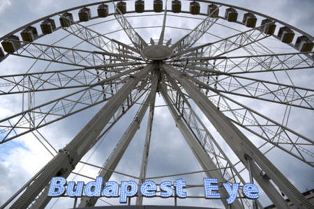 Budapest, Hungary 04.24.2019: The 65m high Budapest Eye Ferris Wheel on Erzsebet Square in Budapest is the best observation point to the whole city