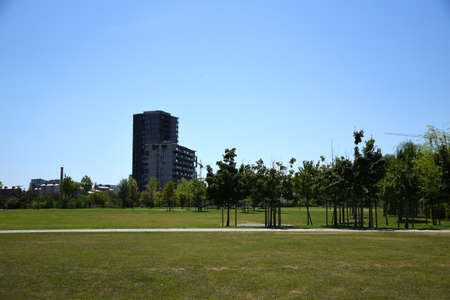 Milan, Italy, 08.04.2019: Newly built or under construction residential buildings with huge parks and flowers in the stunning, beautiful and new Uptown Milan. It is the first Smart District of Milan