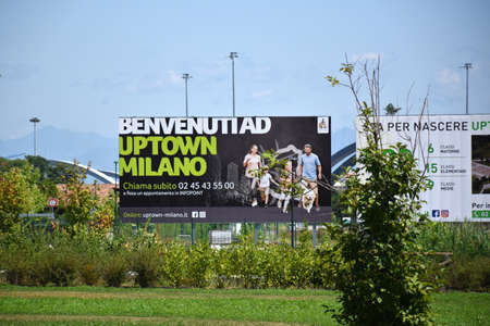 """Milan, Italy, 08.04.2019: """"Welcome to Uptown Milan"""" Advertisement of the stunning, beautiful and new Uptown Milan. It is the first Smart District of Milan"""