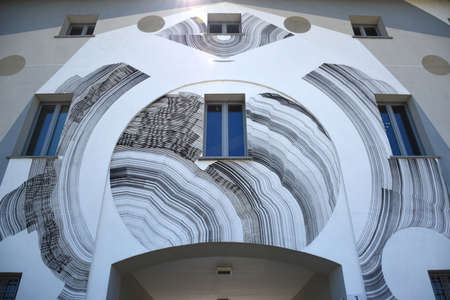 Milan, Italy, 08.04.2019: Community Building with a beautiful, modern, abstract, light colored wall painting in the stunning, beautiful and new Uptown Milan. It is the first Smart District of Milan