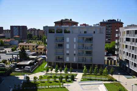 Milan, Italy, 08.04.2019: Newly built or under construction residential buildings with huge parks and flowers in the stunning, beautiful and new Uptown Milan. It is the first Smart District of Milan Stock fotó