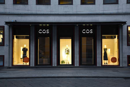 Milan, Italy, 08.04.2019: Storefront, entrancevand facade of COS Store (fashion brand for women, men who want modern, functional, considered design) in De Agostini Building in Brera Art District.