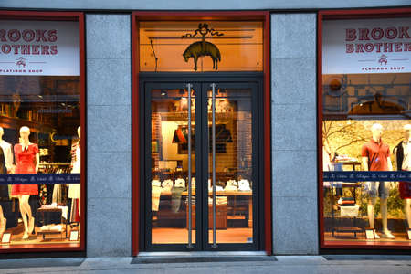 Milan, Italy, 08.04.2019: Storefront and entrance of the Brooks Brothers Store in the Brera Art District which is a romantic, artists' neighborhood and a place of bohemian atmosphere Stock Photo