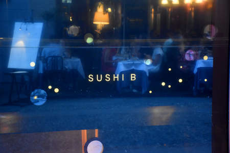 Milan, Italy, 08.04.2019: Reflecting display of the famous, luxury, exclusive Sushi-B Japanese Restaurant and Cocktail Bar in the romantic, artist neighborhood Brera Art District 写真素材
