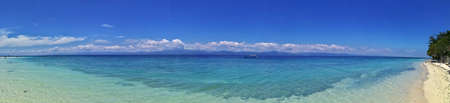 View of the stunning White Sand Beach and the turquoise ocean in Moalboal, Cebu, Philippines