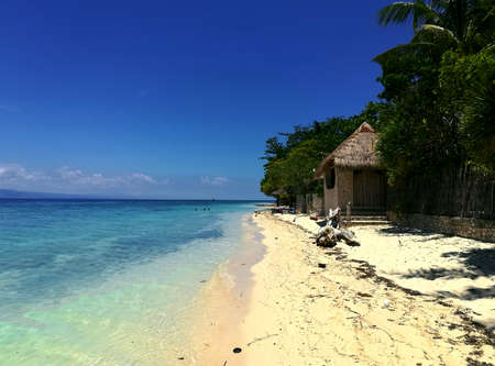 View of the stunning White Sand Beach and the turquoise ocean in Moalboal, Cebu, Philippines Stock Photo