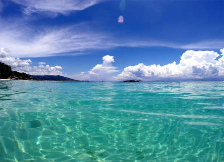 View of the stunning Lambug White Sand Beach and the turquoise ocean in Moalboal, Cebu, Philippines