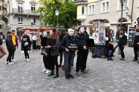 Zurich, Switzerland 09.29.2019: Anonymous for the Voiceless, members of the Cube of Truth Vegan protest group in Guy Fawkes masks protesting about cruelty to animals