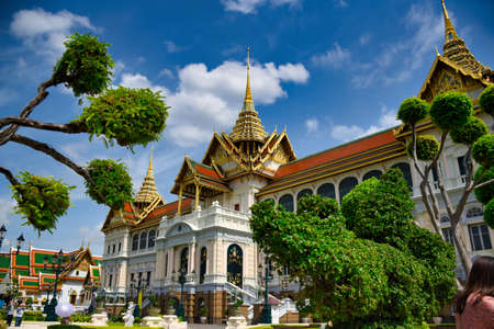 Characteristics of traditional Thai architecture created by artists who transform imagination to reality. Detailed, golden steeply-sloping tile roofs, up turned edges, open air spaces, lush gardens Stock fotó