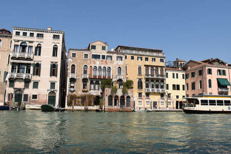 Venice, Italy, 04.19.2019: Beautiful, stunning cityscape view of the lovely, romantic Venice with the Grand Canal, Canale Grande, smaller canals, with gondolas and boats, with bridges and rialtos Editorial