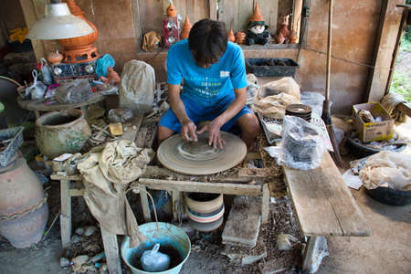 Koh Kret, Thailand 01.04.2020: Koh Kret Pottery Village, locals create their pottery from scratch. They start by shaping the goods on the wheel, then carefully etch in patterns one stroke at a time