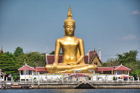 A giant golden Buddha in Maravijaya attitude is an attitude of Buddha in Thai art of which the seated Buddha is putting his hand in the relax posture towards to the ground, loosely holding his knee