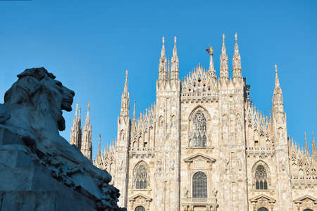 The golden sunshine is reflecting on the front of the magnificent Duomo di Milano or Milan Cathedral after Italy eases coronavirus restrictions after two month lockdown