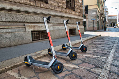Milan, Italy 08.08.2020: Electric scooters parking in downtown Milan