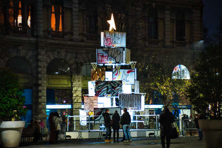 Milan, Italy 12.12.2020, Colorful, glowing, decorative designer Christmas tree on the streets of Milan